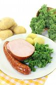 stock photo of peeing  - a white plate with kale smoked meat and pee sausage - JPG