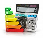 picture of comparison  - Color energy efficiency rating comparison scale and office electronic calculator isolated on white background with reflection effect - JPG