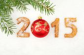 stock photo of pine-needle  - Date new year of 2015 homemade on snow with pine needle with red bauble - JPG