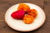 pic of prickly pears  - Prickly pear cut on plate on wooden table - JPG