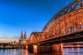 stock photo of koln  - Cityscape of Cologne from the Rhine river with blue sky at sunset - JPG