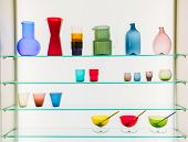 image of pitcher  - Assorted Different Sizes And Shapes Of Colorful Glassware On Shelves - JPG