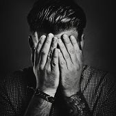 picture of blind man  - Portrait of a tattooed guy hiding his face - JPG