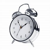 foto of chronometer  - Five minutes to two on the metal alarm clock - JPG