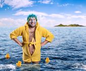 foto of madman  - Strange man with face pack stands in water - JPG