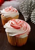 foto of peppermint  - Peppermint cupcakes on a table with a Santa hat and Christmas ornaments - JPG
