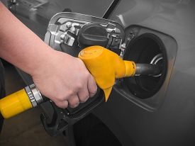 stock photo of gas-pipes  - Pumping gas at gas pump - JPG