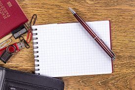 stock photo of passport template  - open notebook with pen on desktop background - JPG