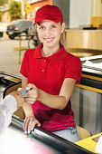 picture of cashiers  - Woman paying cashier at the cash counter in the supermarket - JPG