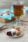 picture of sugar  - Chocolate homemade cookies in powdered sugar with tea and caramel sugar on a wooden background - JPG