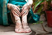 stock photo of adornment  - Indian hindu bride with mehendi heena on feet - JPG