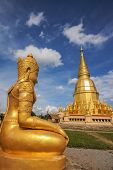stock photo of goddess  - Gold pagoda with gold goddess statue in Buddhist temple - JPG
