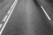 picture of divider  - Asphalt road with dividing lines and tire tracks - JPG