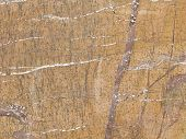 stock photo of slab  - natural brown marble with different shades beautiful stains and stripes in a large slab - JPG