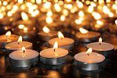 pic of memorial  - burning memorial candles on the dark background - JPG