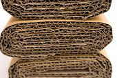 picture of section  - cross sections of brown folded corrugated cardboard