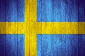stock photo of sweden flag  - Sweden flag or Swedish banner on wooden boards background - JPG