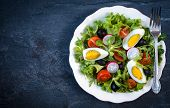 pic of boil  - Boiled eggs salad with vegetables in the plate selective focus and blank space - JPG