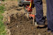 stock photo of plow  - Closeup of hand motor plow blade throwing clay - JPG