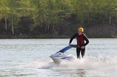 image of jet-ski  - A man turn on the jet ski.