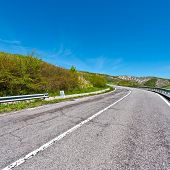 stock photo of apennines  - Asphalt Road on the Slopes of the Apennine Mountains in Italy - JPG