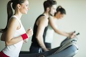 pic of treadmill  - Young people training on a treadmill in the gym - JPG