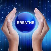 pic of stress-ball  - Hand showing blue crystal ball with breathe word - JPG