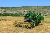 picture of combine  - Combine harvester on a wheat field in Turkey - JPG