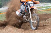 stock photo of motocross  - Motocross bikes street racing on the mountain - JPG