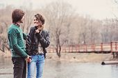 foto of early spring  - Young happy loving couple having fun on the walk in early spring - JPG