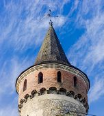 foto of wind-vane  - One of the towers of ancient Kamenetz - JPG