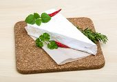 pic of brie cheese  - Soft brie cheese with rosemary thyme on the wood background - JPG