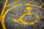 foto of handicap  - image of old Handicapped symbol on parking space - JPG