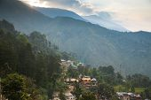 image of lamas  - Sunrise over McLeodGanj the residence town of Dalai Lama Dharamsala India - JPG