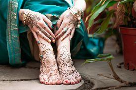 stock photo of mehndi  - Indian hindu bride with mehendi heena on feet - JPG