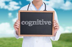 stock photo of cognitive  - The word cognitive and doctor showing little blackboard against field and sky - JPG