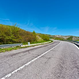 picture of apennines  - Asphalt Road on the Slopes of the Apennine Mountains in Italy - JPG