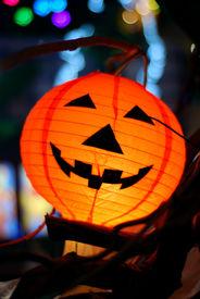 stock photo of jack-o-laterns-jack-o-latern  - smiling halloween lantern on the dark night - JPG