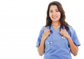 picture of scrubs  - Stock image of happy female healthcare worker wearing scrubs isolated on white with copy space - JPG
