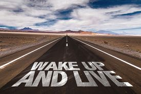 stock photo of follow-up  - Wake Up and Live written on desert road - JPG