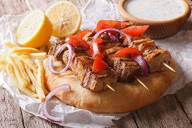 picture of souvlaki  - Greek souvlaki kebab with pita bread and vegetables close - JPG