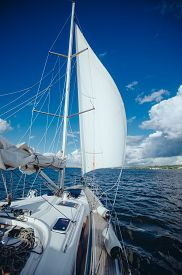 picture of sails  - View from the board of a sailing yacht on the waters - JPG