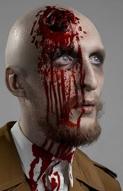 pic of madman  - bald man with a broken head a bloody man with a beard - JPG