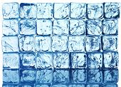 stock photo of ice cube  - background with ice cubes in blue light - JPG