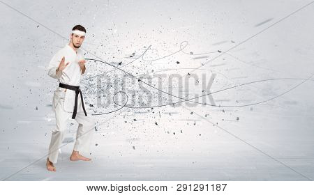 Young karate trainer doing karate
