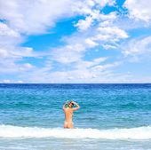 foto of nacked  - beautiful blonde topless woman in the sea  wearing white thong - JPG