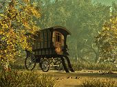 stock photo of gypsy  - a colorfully painted gypsy caravan in a rural environment - JPG