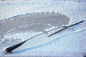 pic of ice-scraper  - Car windshield covered with ice and snow - JPG