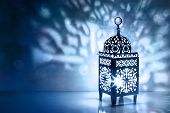 Silhouette Of Moroccan Lantern With Burning Glowing Candle. Decorative Shadows. Festive Greeting Car poster