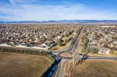 typical residential neighborhood and roundabout along Front Range of Rocky Mountains in Colorado, ae poster